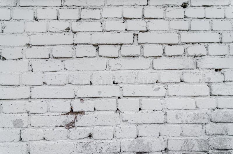 Gammal vit texturerad bakgrund för tegelstenvägg TappningBrickwall fyrkant kalkad textur Tvättad murverkyttersida för Grunge vit  arkivfoto