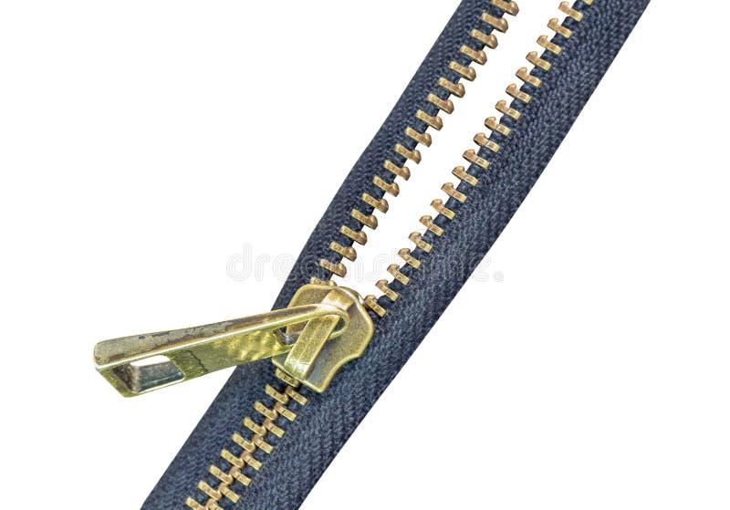Gammal zipperisolat av brass på vit bakgrund royaltyfri fotografi