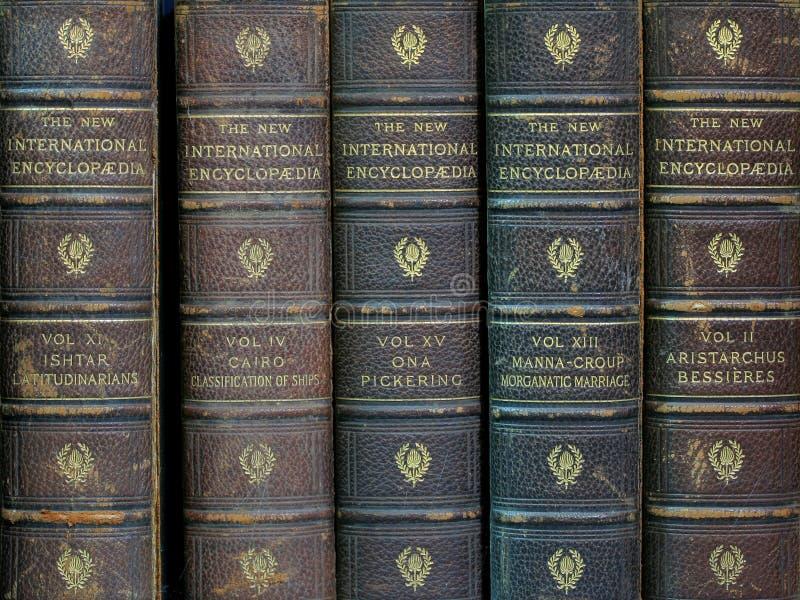 gammala encyklopedier royaltyfria bilder