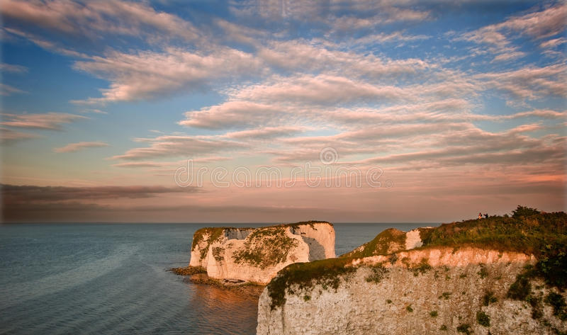 Gammala Harry vaggar Jurassic seglar utmed kusten UNESCO England royaltyfria bilder