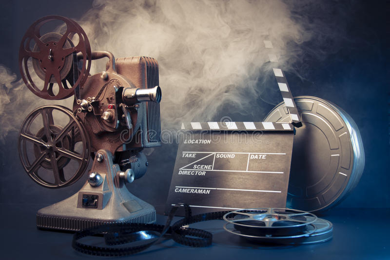 Gammala objekt för filmprojektor och film royaltyfri foto