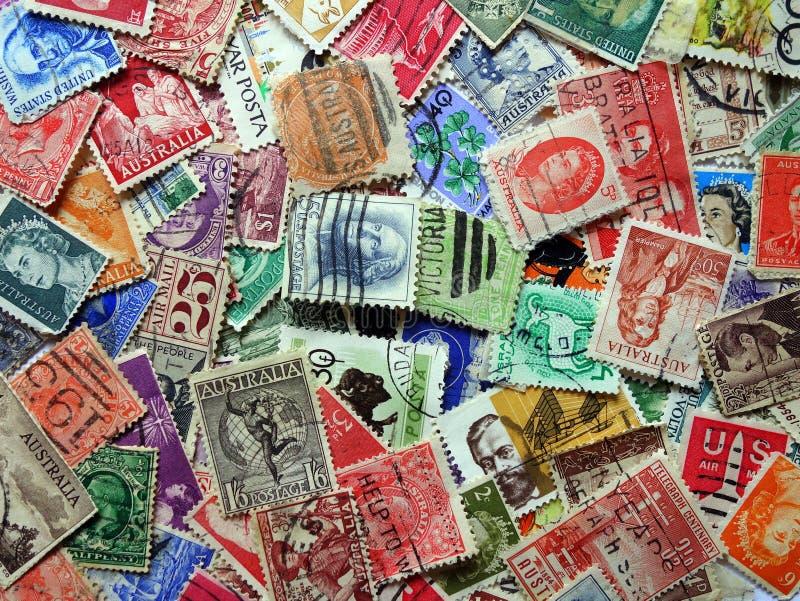 gammala portostämplar royaltyfria bilder