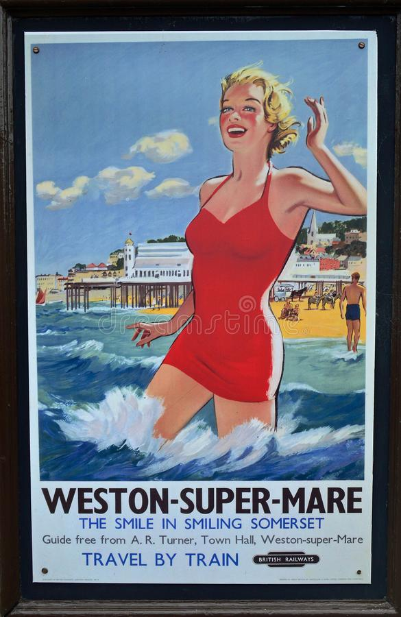 Gammalmodig annonsering för att resa med drevet till Weston Super Mare fotografering för bildbyråer