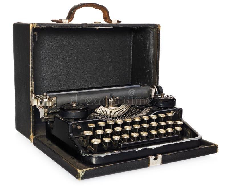 Gammalt antikt, tappning, bärbar skrivmaskin i ett öppet läder ca arkivbilder