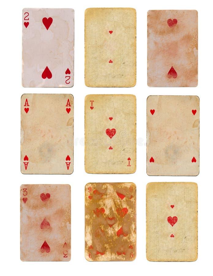 Gammalt använt spela kort för samling av isolerade pappers- bakgrunder för hjärtor royaltyfri fotografi