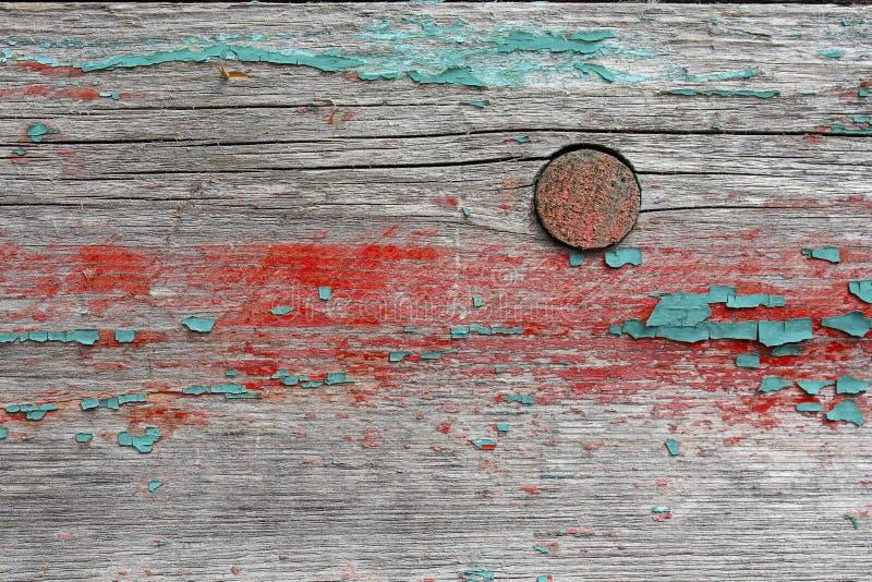 Gammalt bräde med restna av målarfärg arkivbilder
