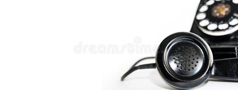 Gammalt för telefonhörlurar med mikrofon för roterande visartavla baner arkivfoton