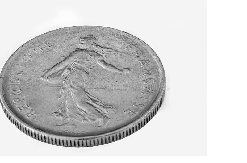 Gammalt franskt mynt isolerad makro royaltyfria foton