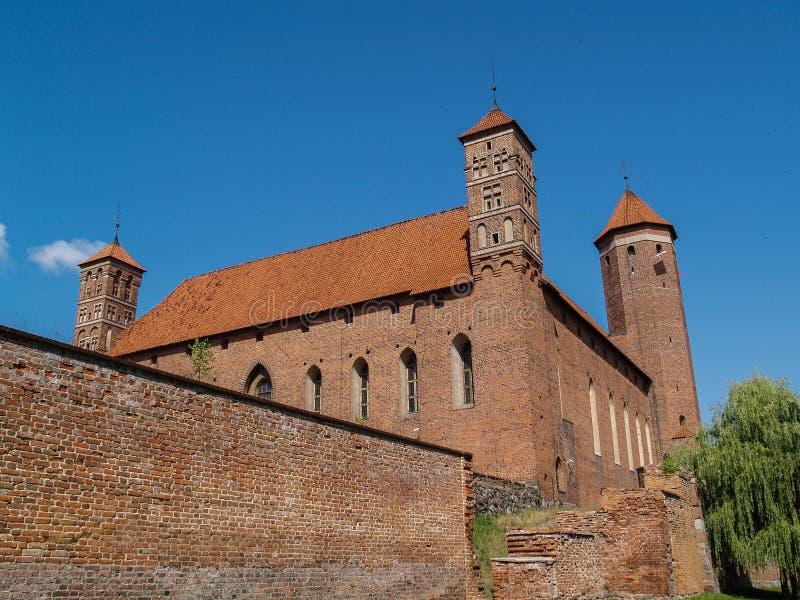 Gammalt gotiskt medeltida slott i Lidzbark Warminski, Warmia region i Polen royaltyfria bilder