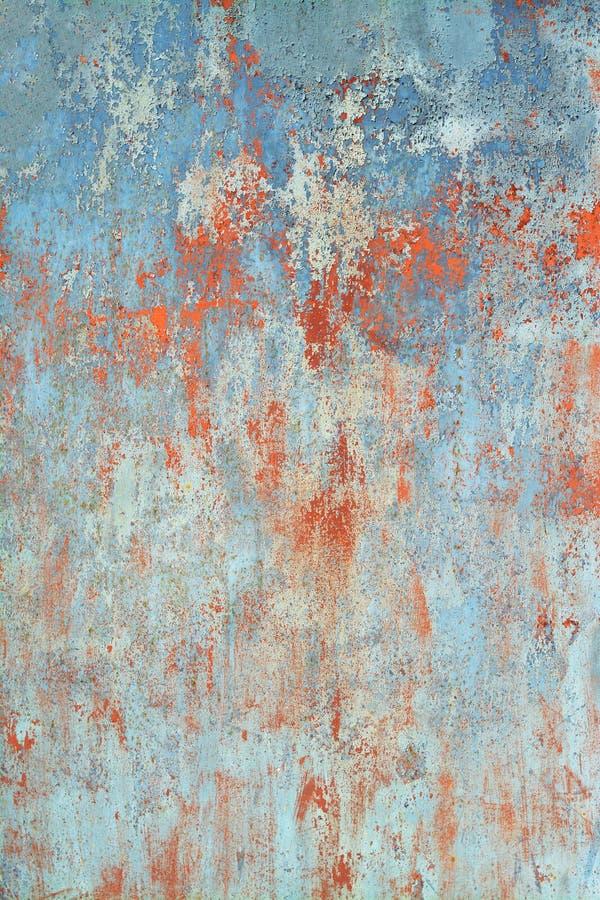 Gammalt grungeljus - blå bakgrund med grov textur royaltyfria foton