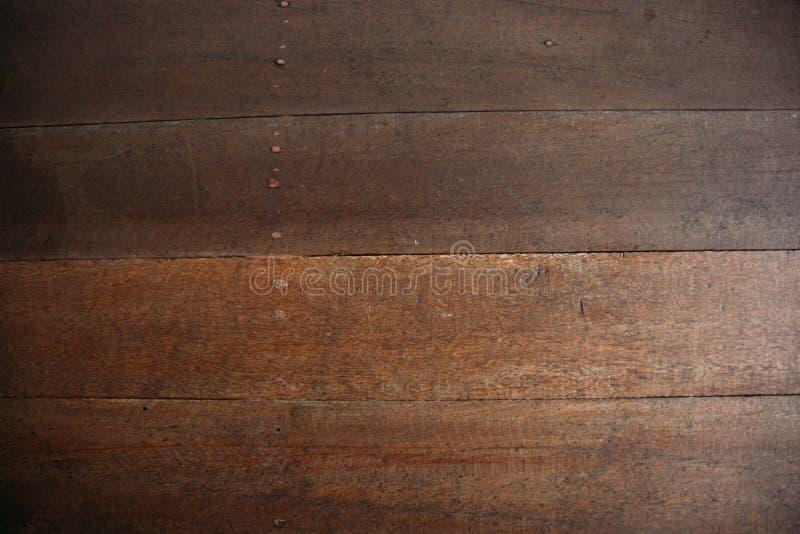 Gammalt grungemörker texturerade träbakgrund, yttersidan av den gamla bruna wood texturen arkivfoto
