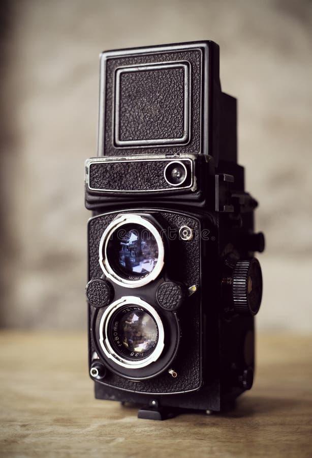 Gammalt kameratappningfilter royaltyfri foto
