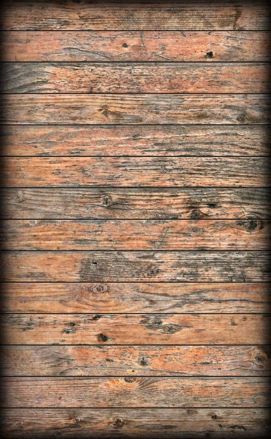 Gammalt knutit ridit ut lantligt sörjer för Vignetted för träplank grov textur Grunge royaltyfri fotografi