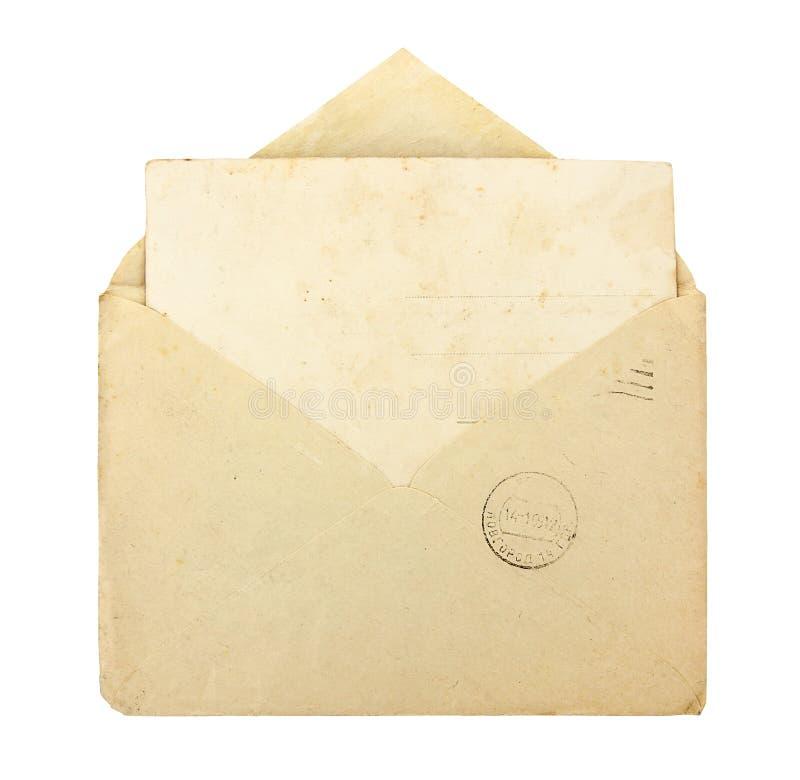 Gammalt kuvert med det tomma kortet arkivfoton