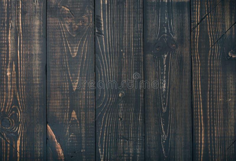 Gammalt mörker bränd wood textur, tapet eller bakgrund arkivbilder