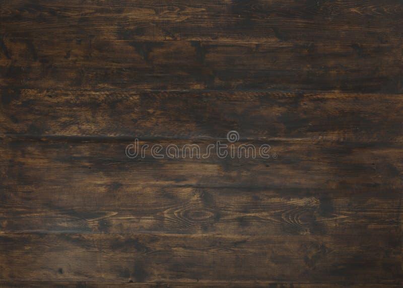 Gammalt mörker texturerade träbakgrund, brunt trä befläckt stil royaltyfri fotografi