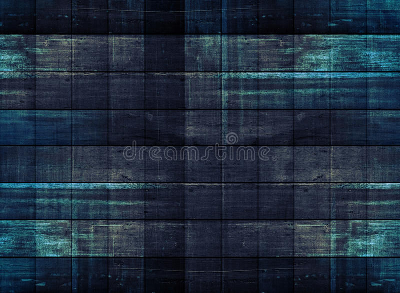 Gammalt mörkt trä med blått som målas, i fyrkantiga modeller royaltyfri bild