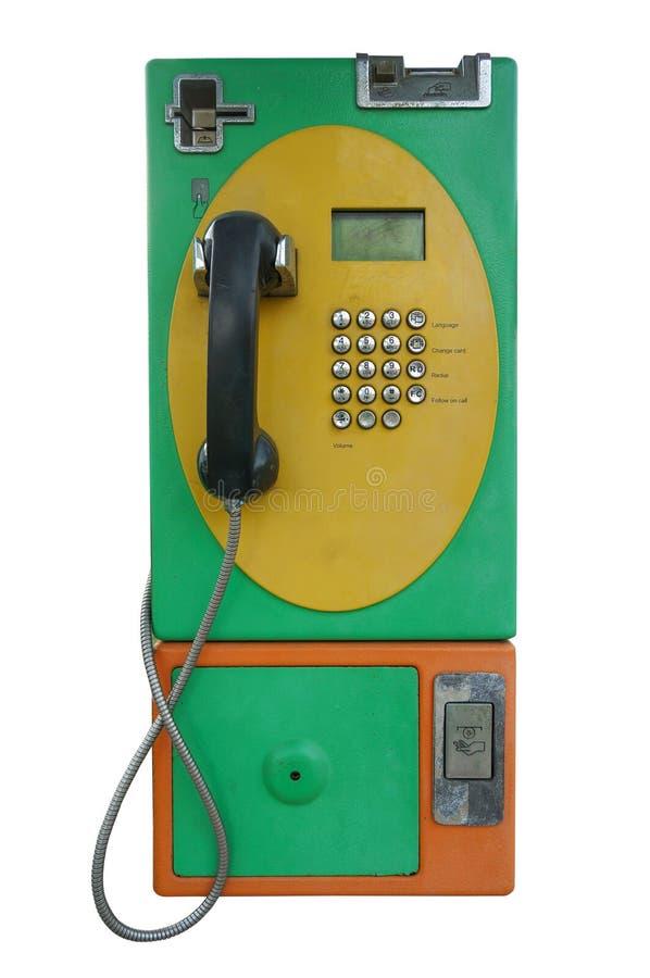 Gammalt mellanläggsmynt och kort för offentlig telefon royaltyfri fotografi