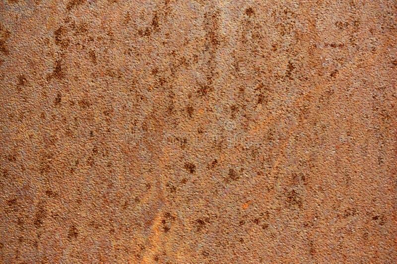 Gammalt metallark av järn med rostabstrakt begreppbakgrund arkivfoto