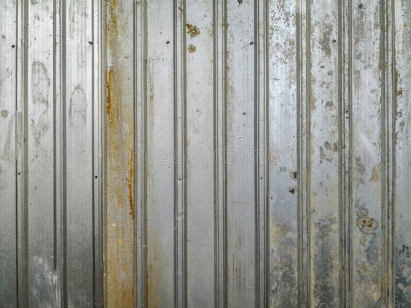 Gammalt metallark med rost och smutsig materiell textur arkivbilder