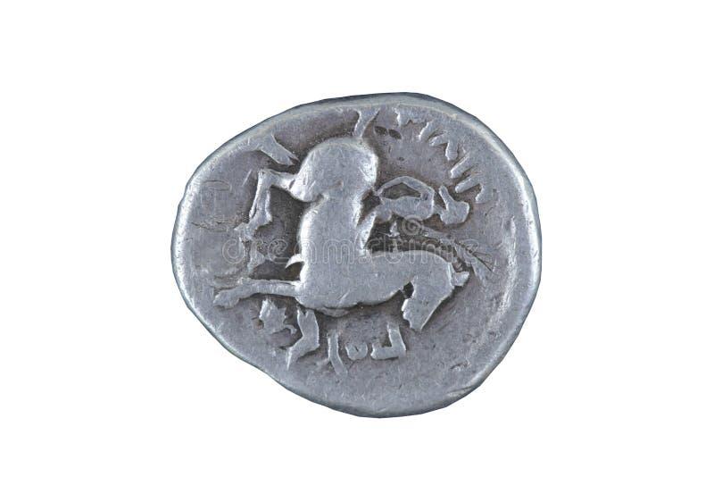 Gammalt mynt som isoleras på vit royaltyfria bilder