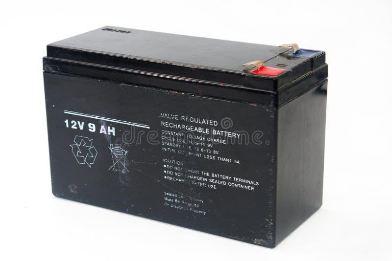 Gammalt och använt svart batteri 12V arkivfoton