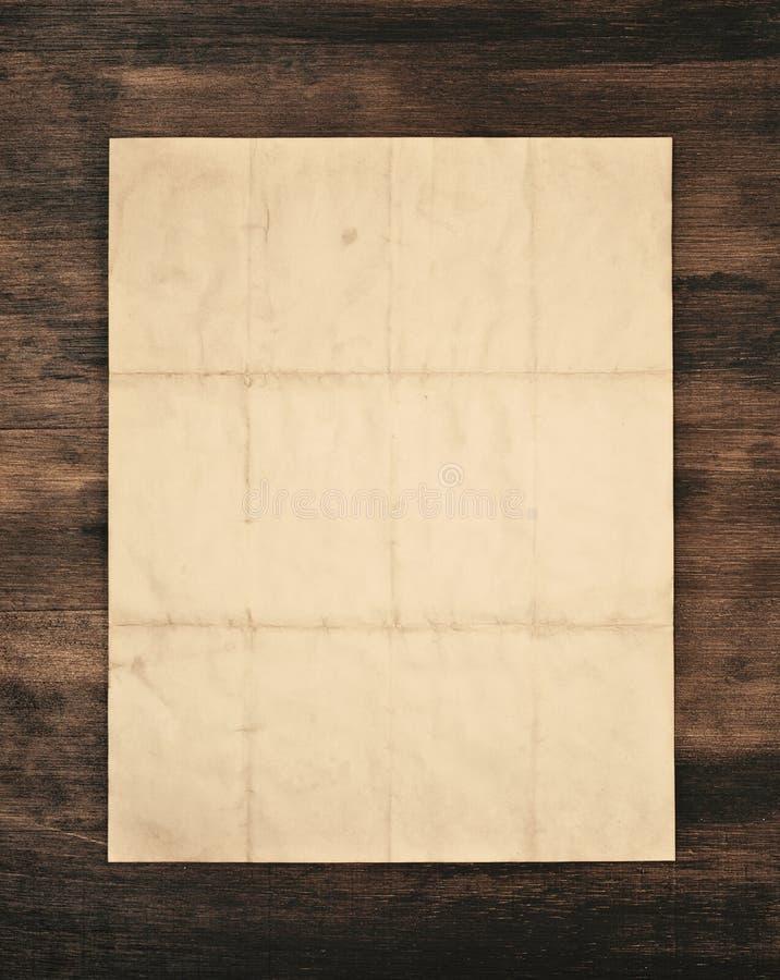 gammalt över paper trä arkivfoto