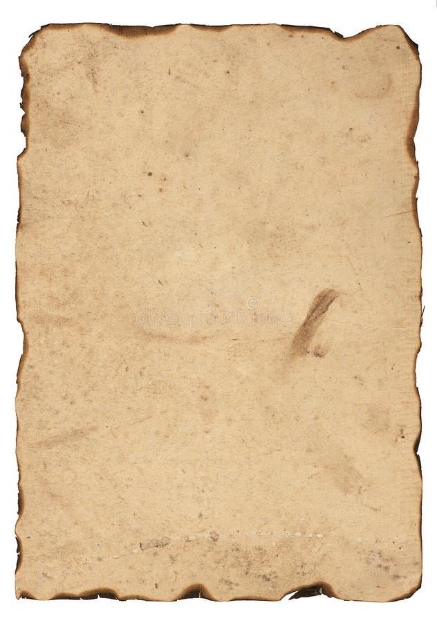Gammalt papper med brända kanter royaltyfria bilder