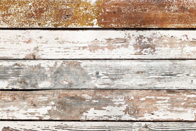 Gammalt sjaskigt träplank arkivfoto