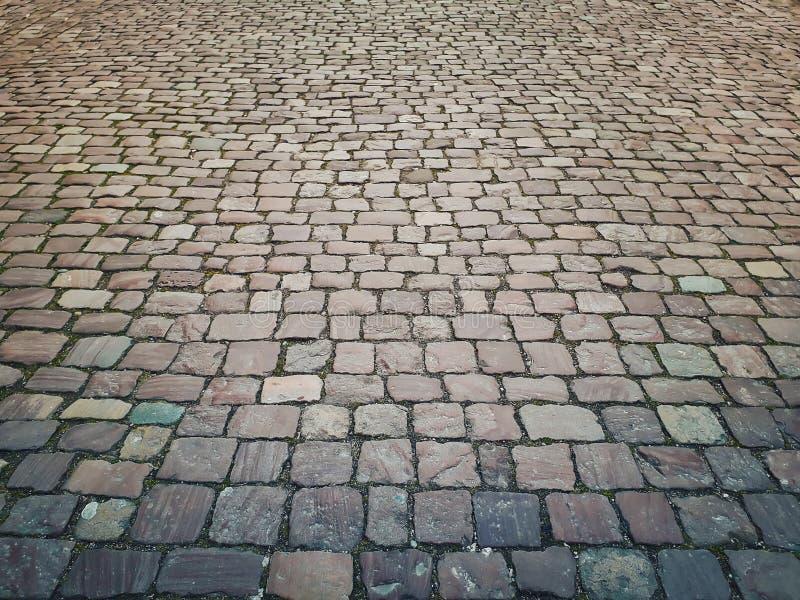 Gammalt stena tappningtrottoartextur Cobblestoned granit royaltyfria bilder