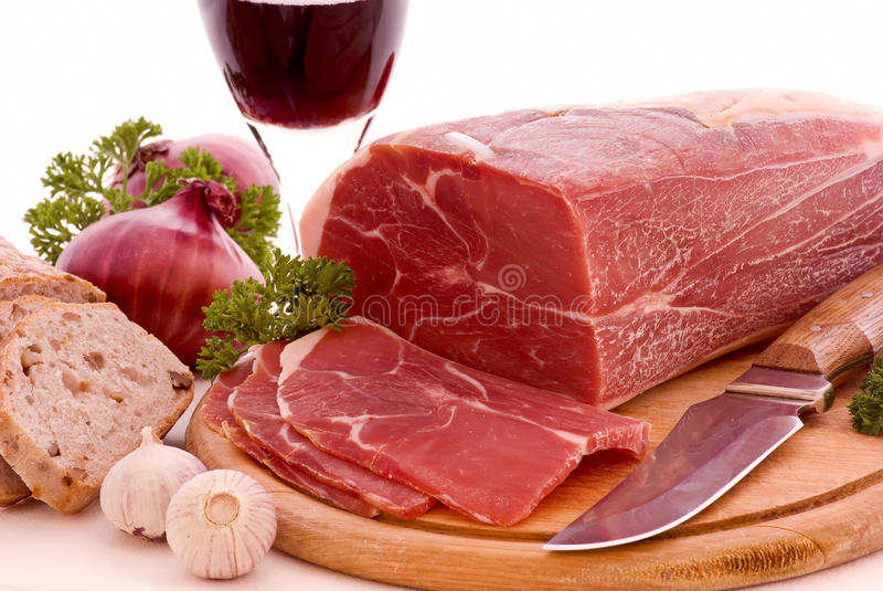 Gammon with Bread and Wine. Gammon Piece on a wooden plate with bread and wine stock images