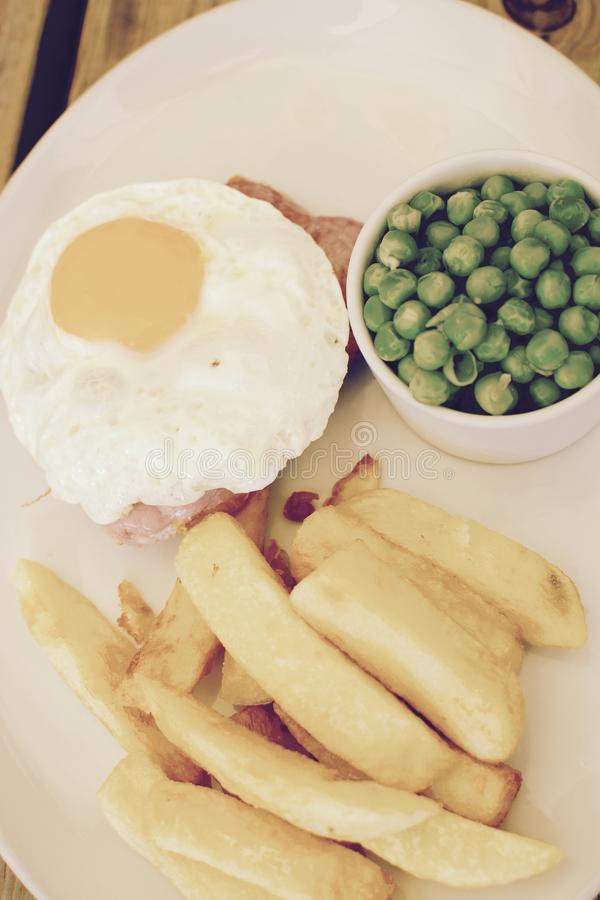 Gammon with chips and fried egg royalty free stock image
