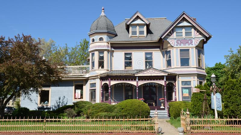 Gammon Corner. This is a Spring picture of the Gammon Corner in Batavia, Illinois. The house built in 1885 is an example of Painted Lady Victorian architecture stock photos
