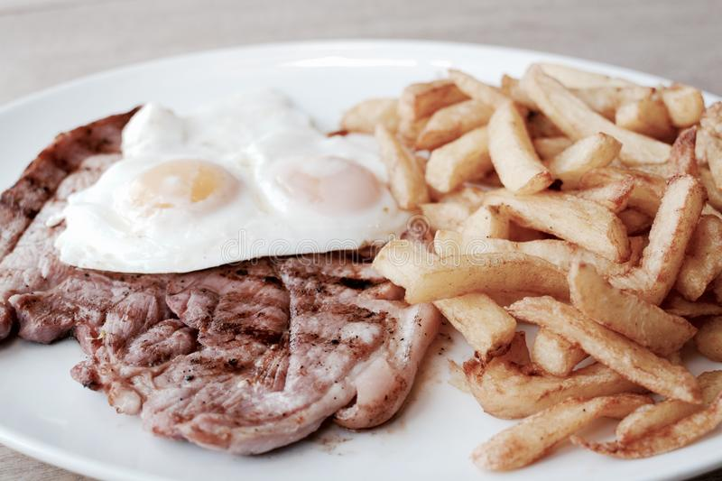 Gammon egg and chips stock photo