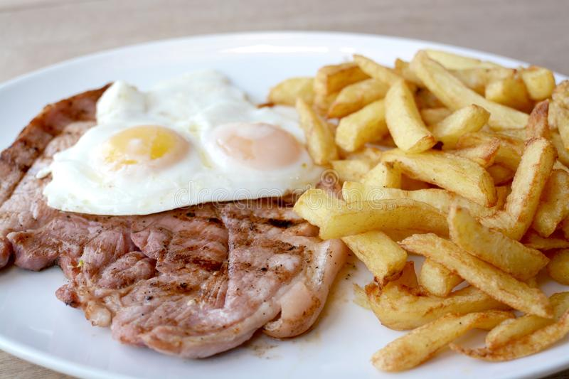 Gammon egg and chips stock photos