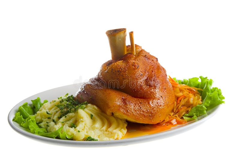 Gammon with potato. Big pork gammon with potato on white plate royalty free stock images