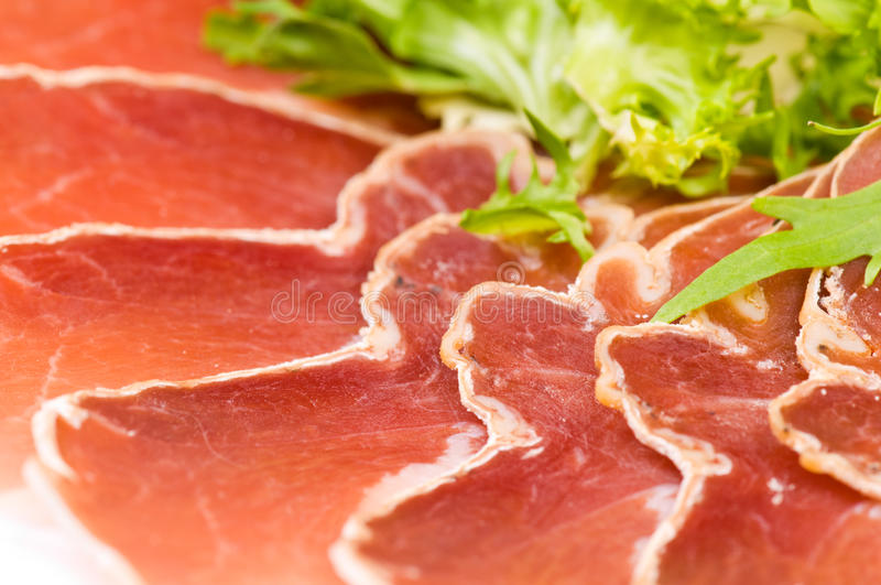 Gammon with salad. On the plate royalty free stock photo
