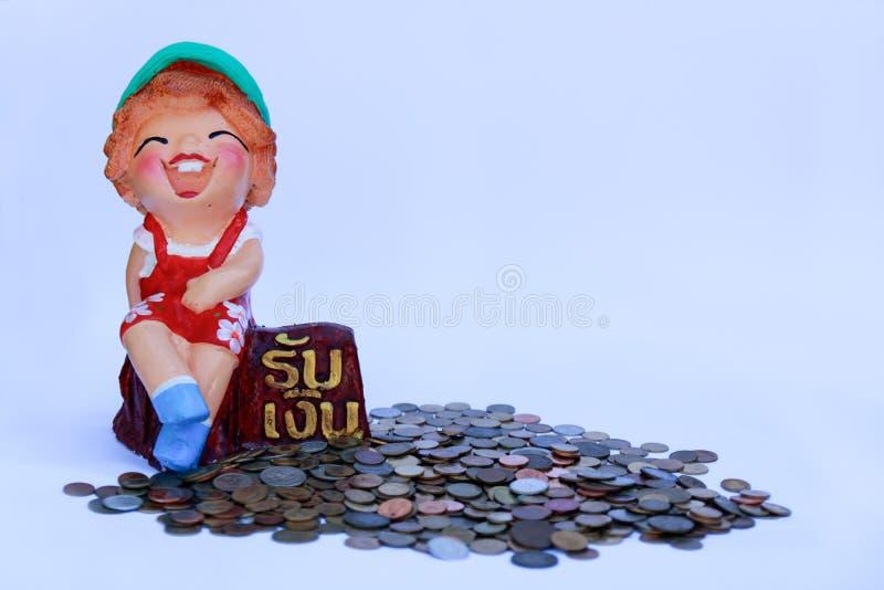 Ganó un poco de muñeca del dinero fotografía de archivo