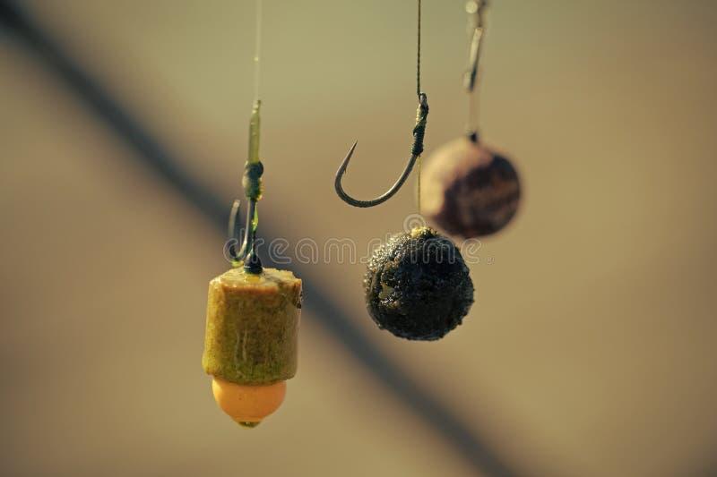 Gancho, cebos de pesca, primer, cebos flotantes para los pescados fotografía de archivo libre de regalías