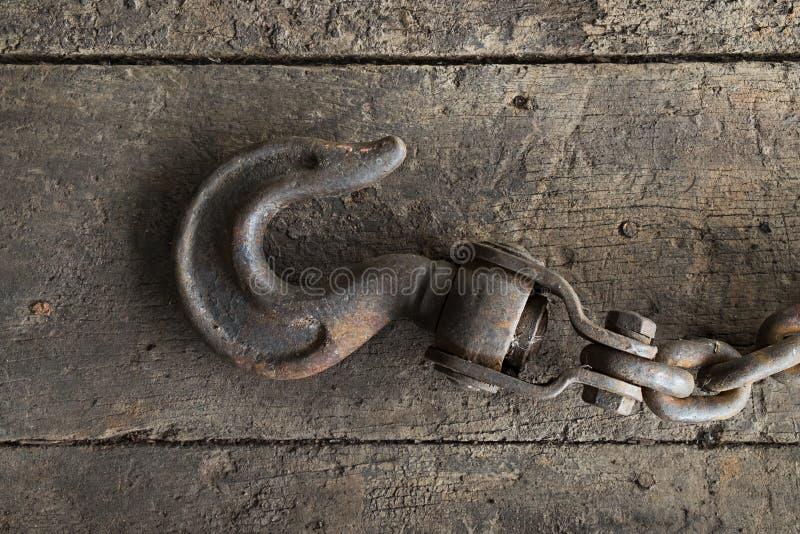 Gancho de aço velho e madeira velha imagem de stock royalty free