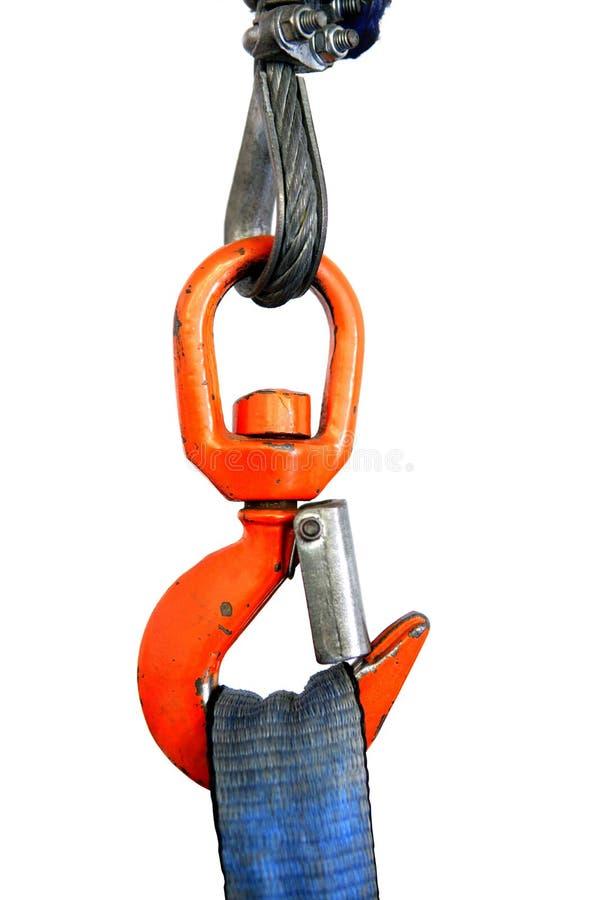 Gancho de leva anaranjado colorido de la grúa que lleva a cabo la cuerda azul de la cinta imágenes de archivo libres de regalías