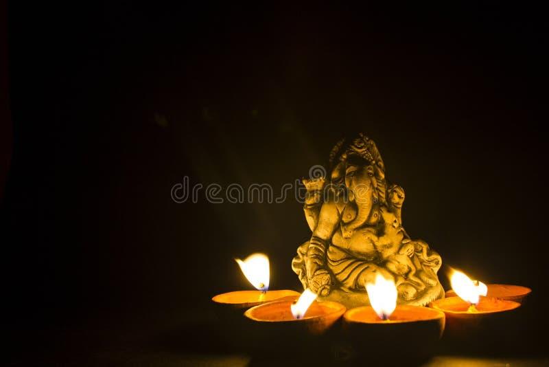 Ganesh do senhor na luz da lâmpada imagens de stock royalty free