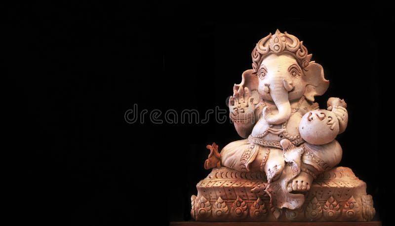 Ganesh statue On the background is a black scene stock photos