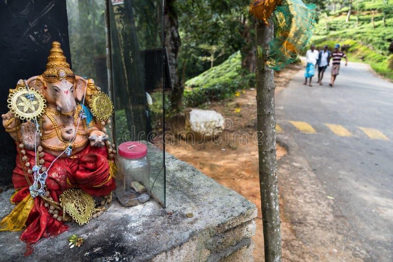 Ganesha小木雕塑在街道上的 库存图片