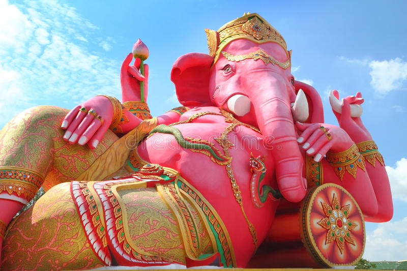 Ganesha god of hindu. Pink ganesha in relaxing protrait on blue sky, Chachoengsao,Thailand royalty free stock photo