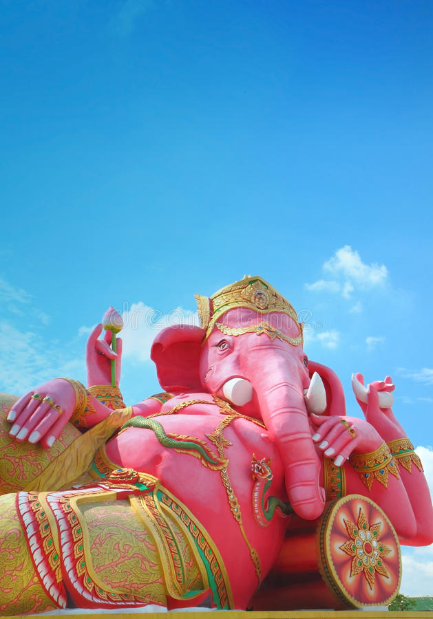 Ganesha god of hindu. Vertical shot of pink ganesha in relaxing protrait on blue sky, Chachoengsao,Thailand stock image