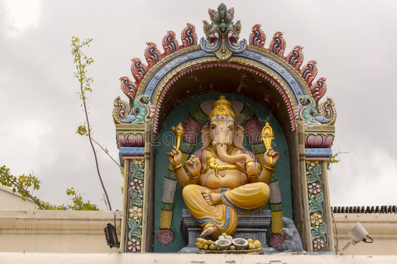 Ganesha at Hindu temple. Although he is known by many attributes, Ganesha`s elephant head makes him easy to identify. Ganesha is widely revered as the remover of royalty free stock image