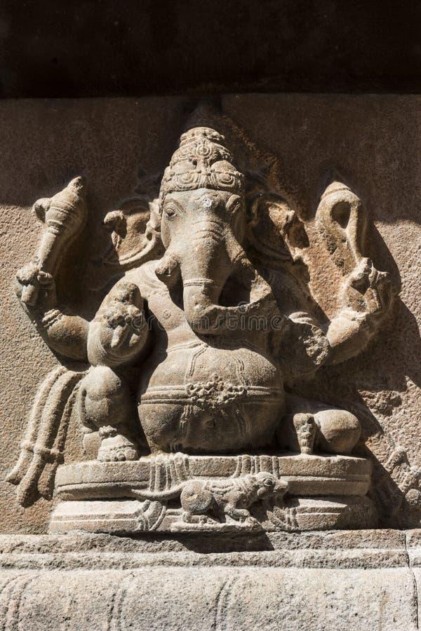 Ganesha Statue阁下在岩石墙壁-坦贾武尔大寺庙上的 图库摄影