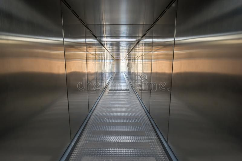 Empty gangway at an airport stock image