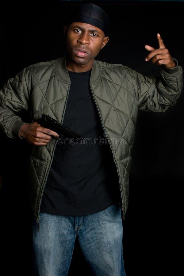 Download Gang Member Holding Gun stock image. Image of teenage - 7449637
